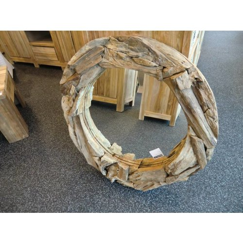 Mirror with a rim consisting of lumps of carrot wood.