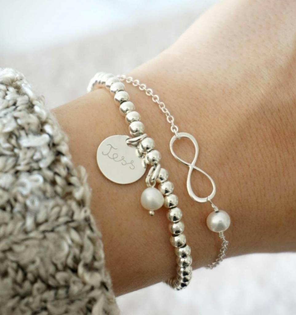 Zilveren armband 'Cute Balls' met gegraveerde bedel