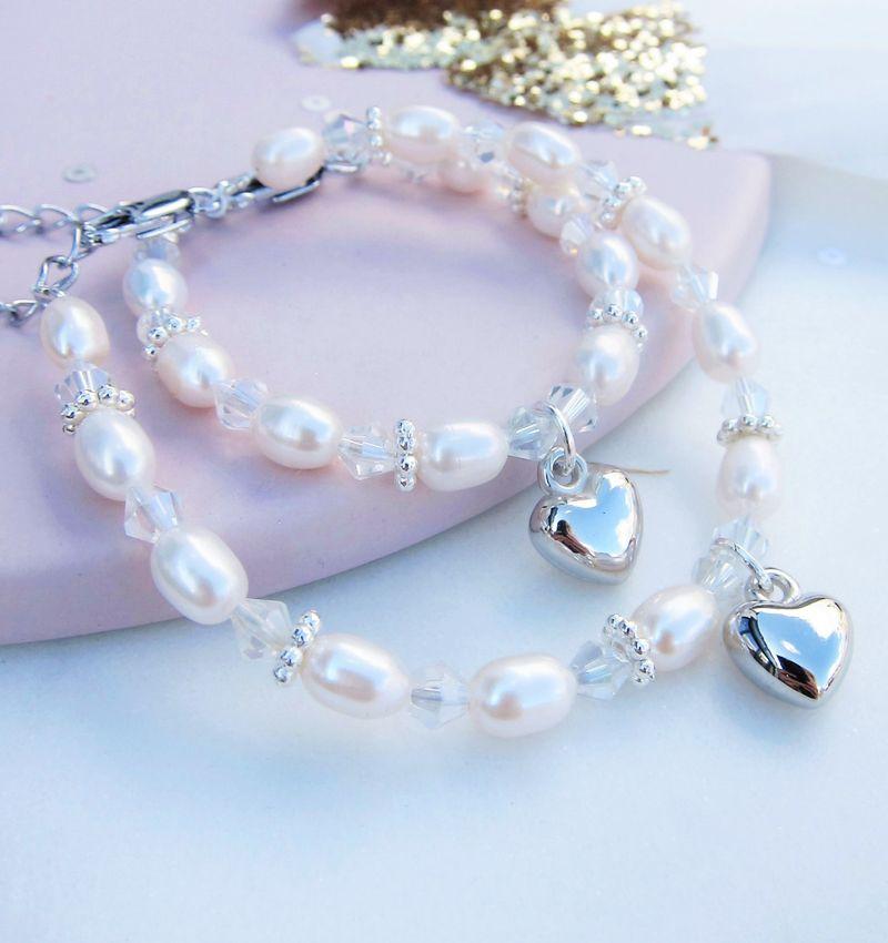 Moeder-dochter armbanden 'Infinity White' met bol hartje