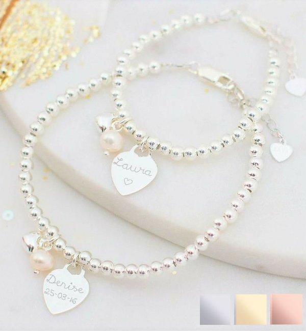 Sieraden graveren Silver bracelets set 'Cute Balls' engraved