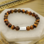 Sieraden graveren Armband Heren met Tijgeroog Kralen