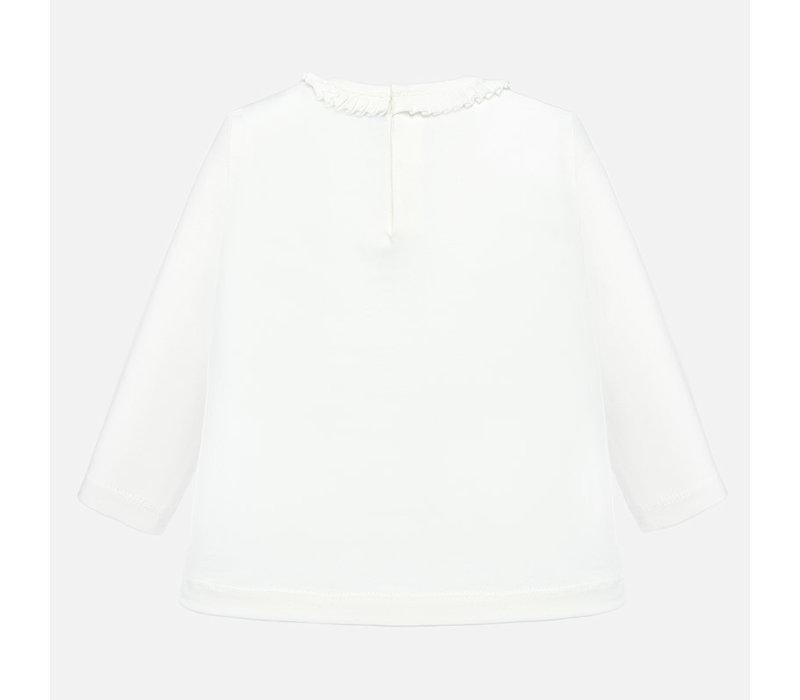 Mayoral  snoezig off-white meisjesshirt met applicatie en zeer fraaie hals.