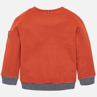 Beautiful orange boy's sweater with application of airplane