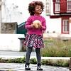 Mayoral Schöner fröhlicher Rock, schwarz mit weißen Punkten und pinkfarbenen Blumen. Mit stylischem Lederband.