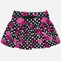 Schöner fröhlicher Rock, schwarz mit weißen Punkten und pinkfarbenen Blumen. Mit stylischem Lederband.