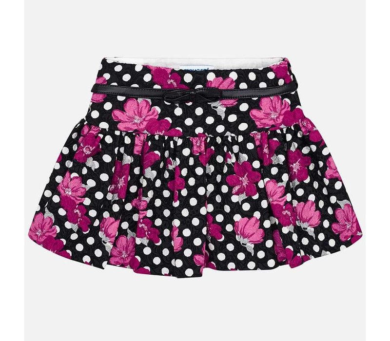 Beautiful cheerful skirt, black with white dots and fuchsia flowers. With stylish leather strap.