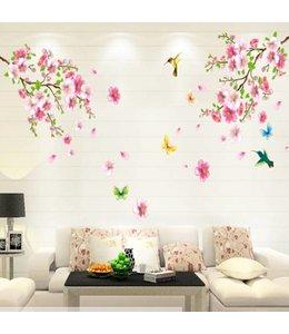 Muursticker twee bloementakken met vogels en vlinders