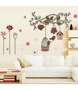 Muursticker tak met bloemen en vogelkooi