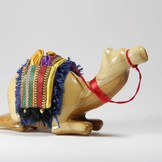 Desert Rose Camel kneeling with saddle made of olivewood