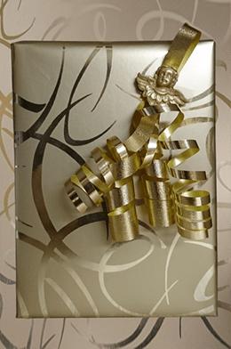 Cadeau papier gouden krullen