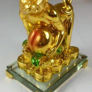 Фигурка Обезьяны с персиками, символизирующая здоровье.