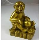 Обезьяна на монетках со слитком золота