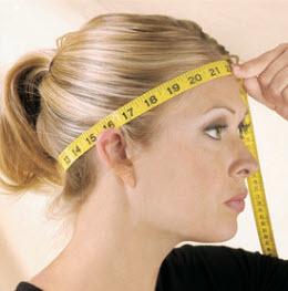 Hoe meet ik de omtrek van mijn hoofd