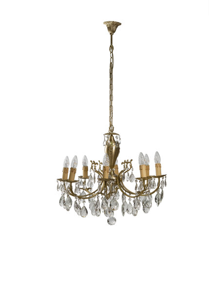 Old chandelier with 8 candles between crystal glass