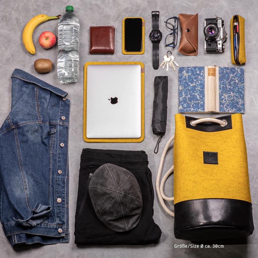 Drawstring duffel bag or backpack MEERWERK from felt mustard mixed & leather black