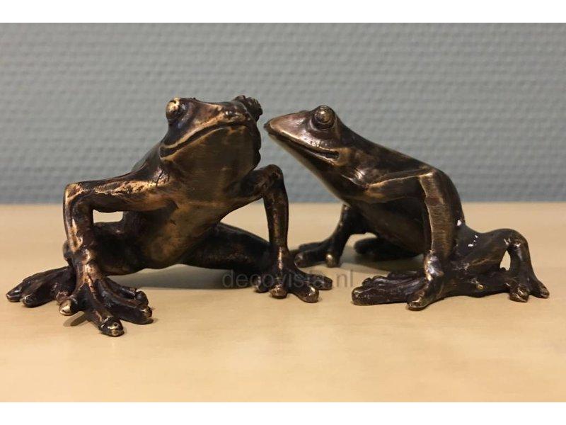 Twee boomkikkers van brons