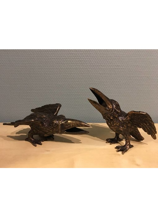 Two bronze crows