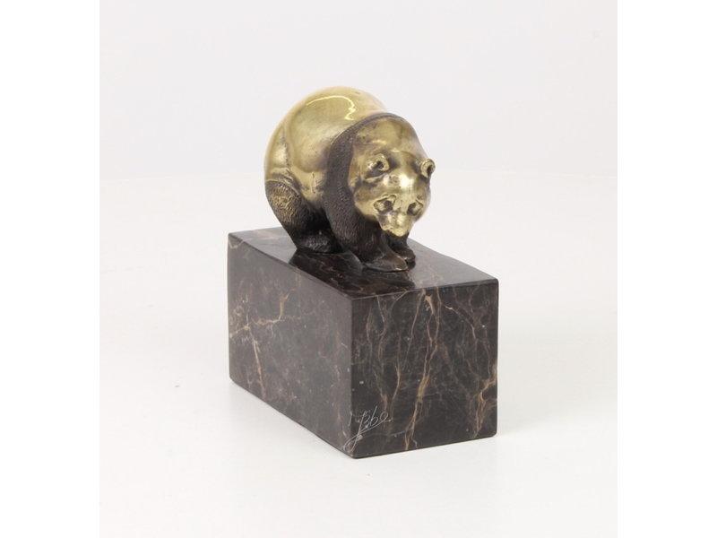 Walking panda bear made of bronze on a block of veined natural stone