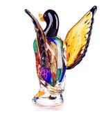 Pato macho de cristal con alas levantadas.