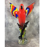 Colorful Scarlet Macaw parrot of glass