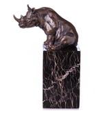 Figurilla de rinoceronte de bronce sobre base de mármol