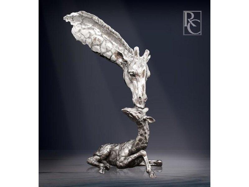 Sculpture mother giraffe with calf