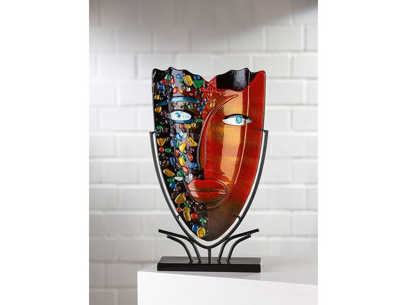 Glass vase with a red face