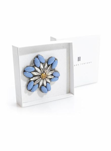 Claes Iversen Claes Iversen, blue coloured brooche with white/yellow stone.