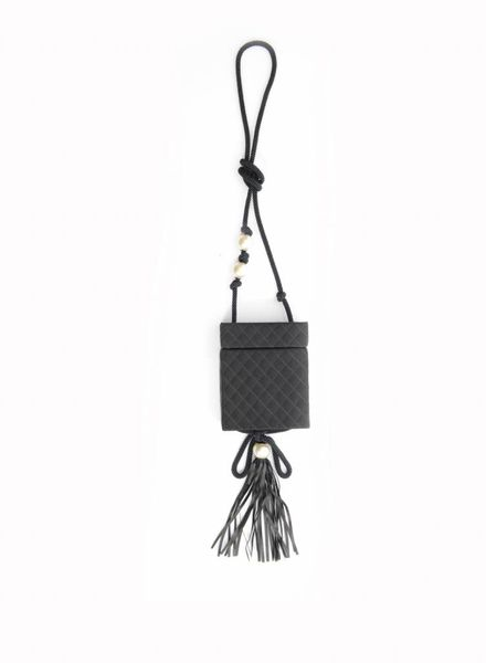 Chanel Chanel, satin quilted box bag with leather fringes and pearls.