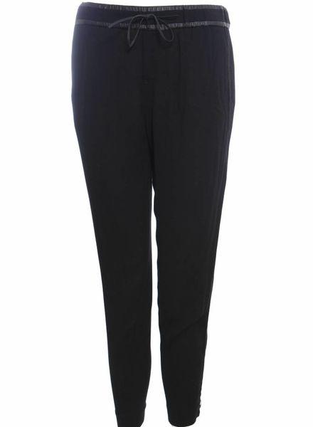 Helmut Lang Helmut Lang, zwarte sportieve pantalon broek met ritsen en leren details in maat 2/M.