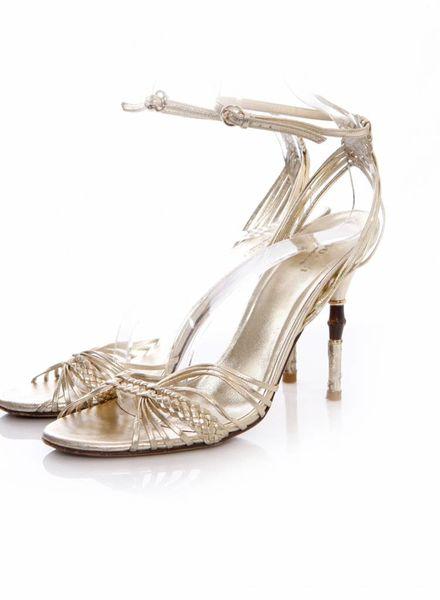 Gucci Gucci, goudkleurige sandalen met bamboo in de hak.