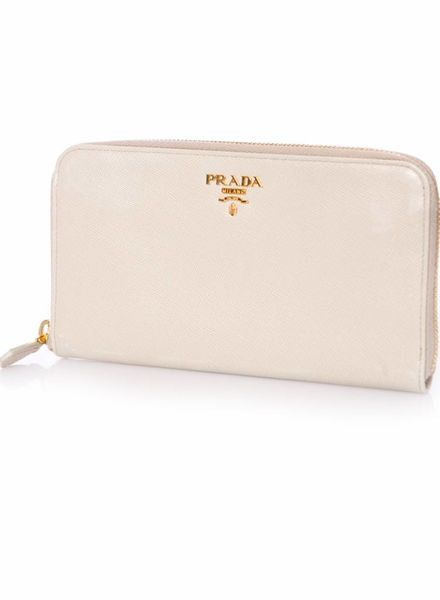 Prada Prada, saffiano leather zip around wallet in beige with golden hardware.