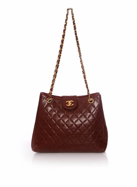 Chanel Chanel, Vintage Quilted burgundy Chanel bag with gold hardware.