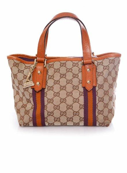 Gucci Gucci, Mini shopper handtas met gouden bedeltjes.