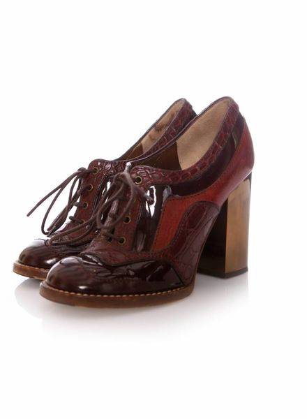 Dolce & Gabbana Dolce & Gabbana heeled brogue lace-up ankle boots in size 38.5.