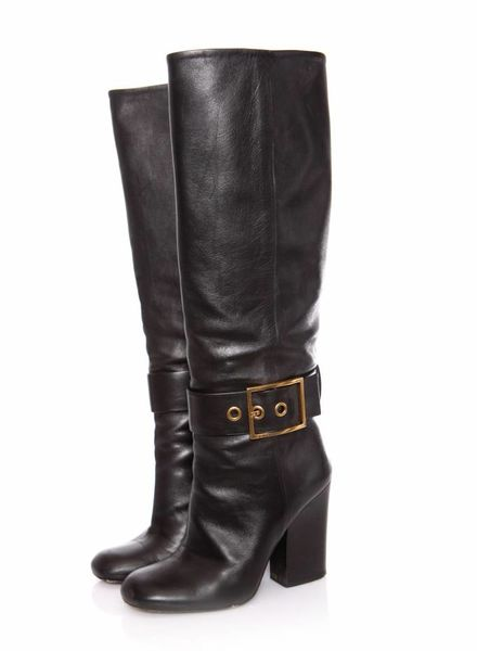 Gucci Gucci, Black leather boots with gold buckles.