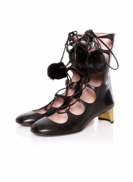 Gucci, high lace-up Arielle boots with fur pom pom in size 38.