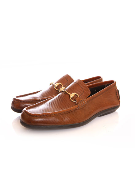 Gucci Gucci, brown leather loafers with horsebit.