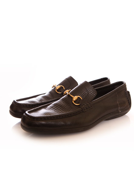 Gucci Gucci, black leather loafers with horsebit.