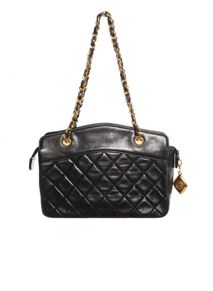 Chanel Chanel, Vintage mini black lambskin quilted handbag with gold hardware.