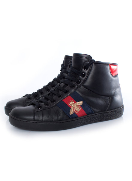 Gucci Gucci, black leather high-top trainers.