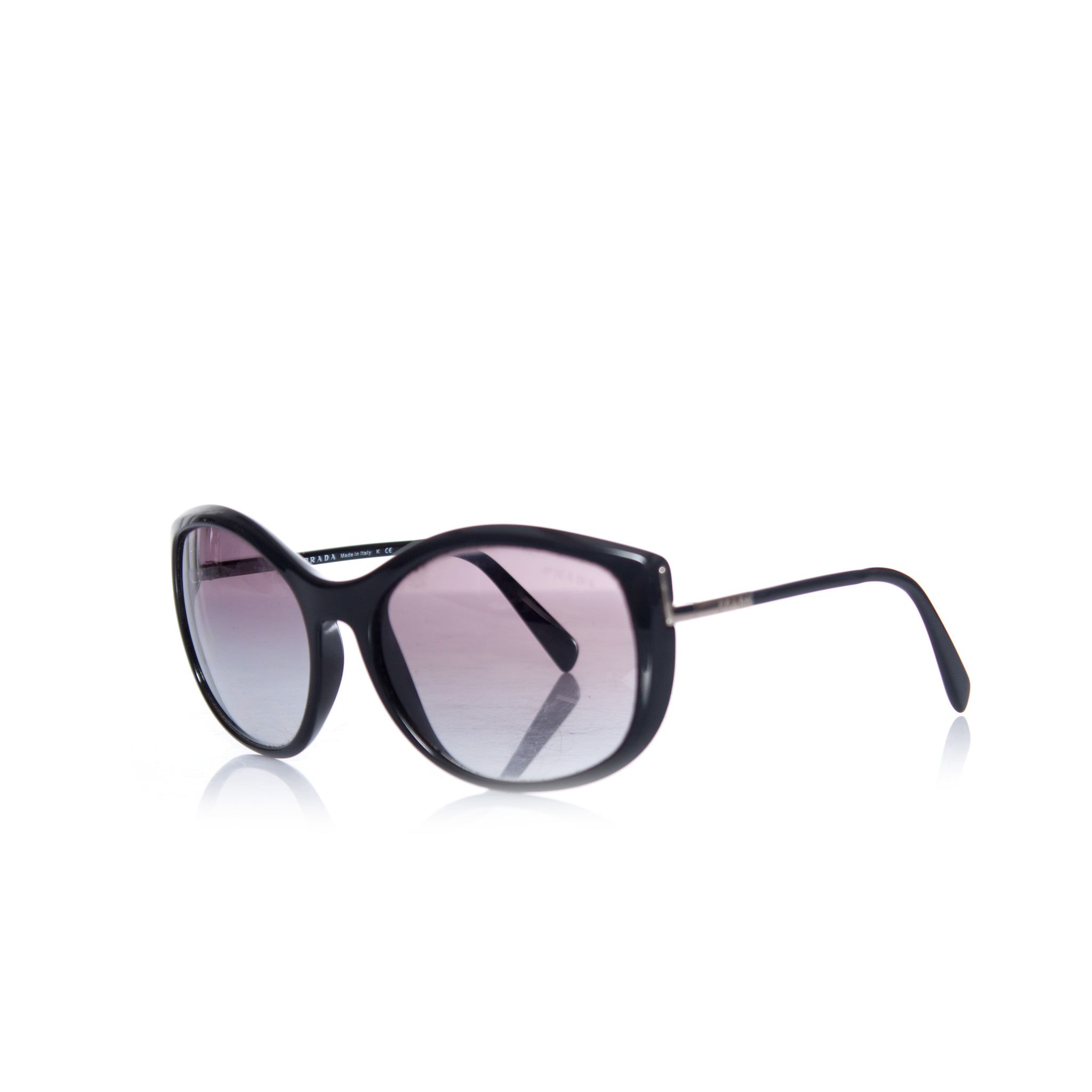 46568a2355 Prada, Black sunglasses. This item has 2 scratches on the left lens further  in good condition.