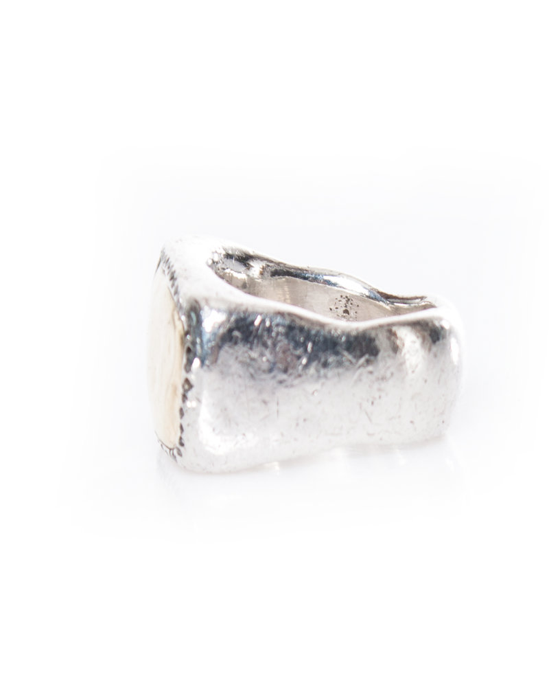 Rosa Maria, Silver Ring with layer of grey diamonds surrounding an 18k gold center.