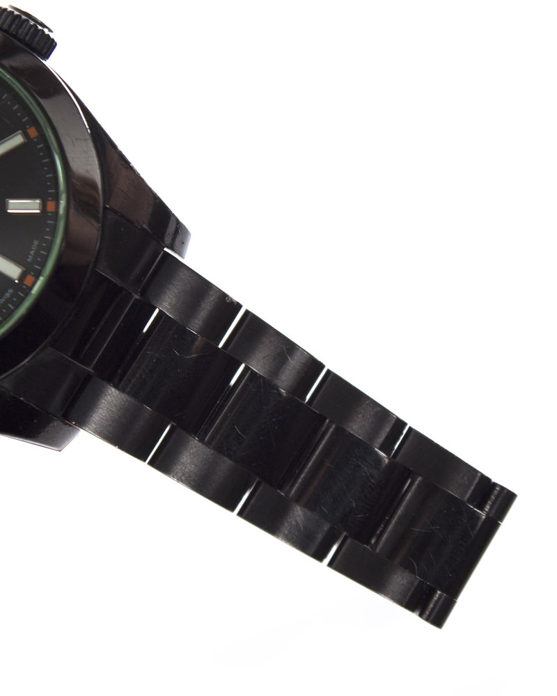 Rolex Milgauss, 116400 Oyster Perpetual stainless steel watch with black dial and green crystal.