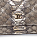 Chanel Chanel, light grey metallic python leather wallet on a chain with gold hardware.