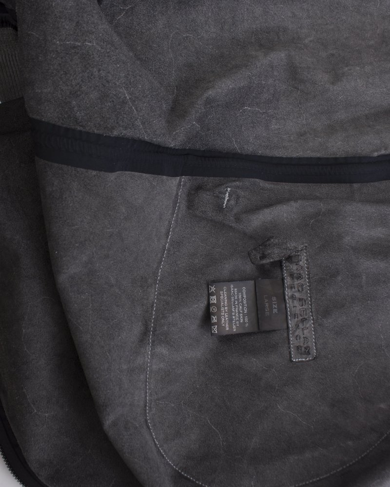 Isaac Sellam experience, Green leather coat.