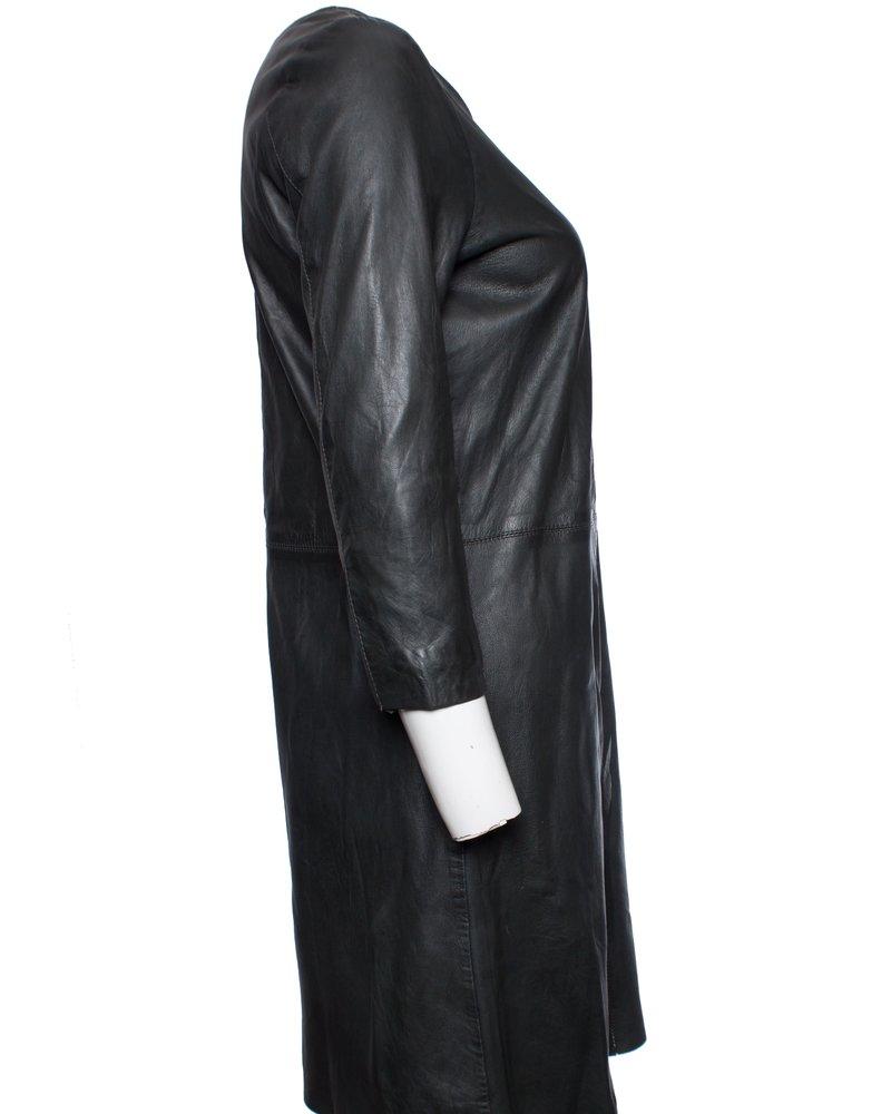 Transmission, Green leather dress