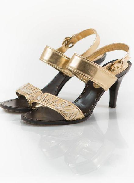 Yves Saint Laurent Yves Saint Laurent, gold leather sandal.