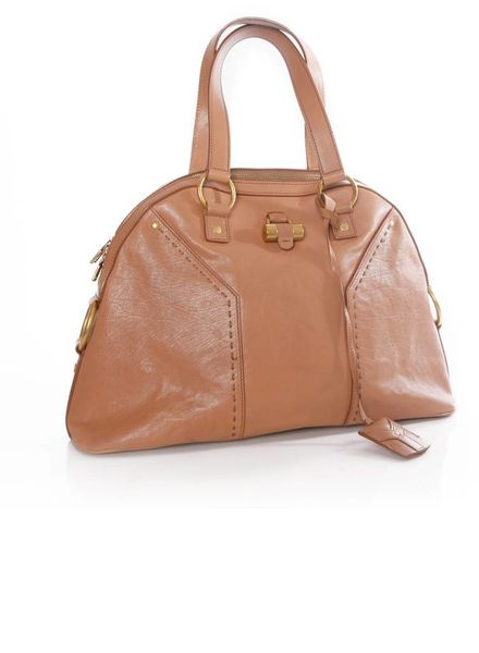 Yves Saint Laurent Yves Saint Laurent, nude colored muse bag with satin lining and golden hardware.