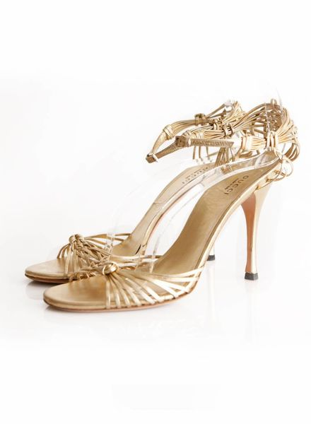 Gucci Gucci, goudkleurige sandalen.